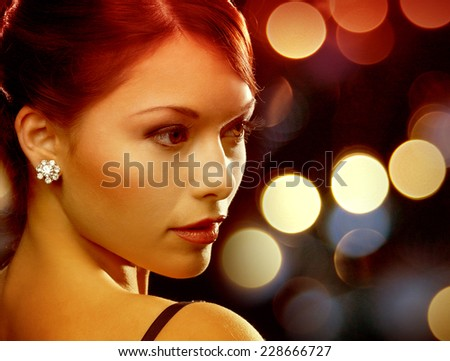 luxury, vip, nightlife, party concept - beautiful woman in evening dress wearing diamond earrings - stock photo