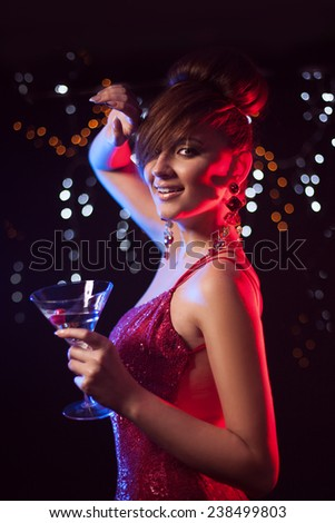 luxury, vip, nightlife, party concept - beautiful woman in evening red dress with cocktail - stock photo