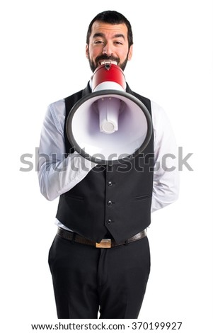Luxury waiter shouting by megaphone - stock photo