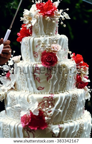 Luxury wedding cake on the table in the restaurant - stock photo