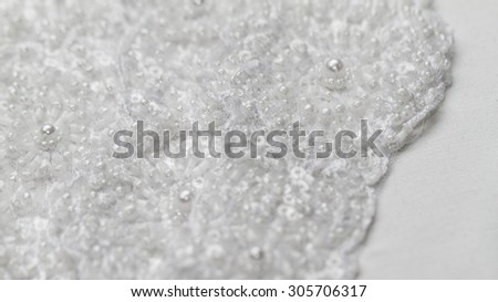 Luxury wedding lace with pearls on white background - stock photo