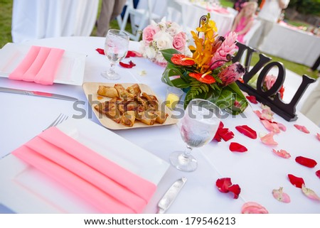 Luxury wedding lunch table setting outdoors, in white and pink colors. - stock photo