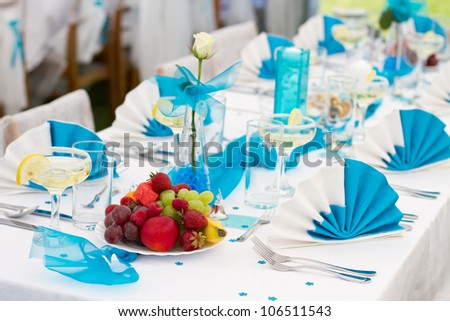 Luxury wedding lunch table setting outdoors, in white-blue colors - stock photo
