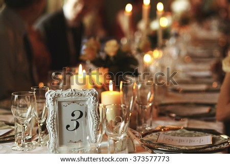 Luxury wedding tables for celebration in dining room - stock photo