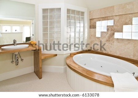 luxury white and wood bathroom with whirlpool tub - stock photo