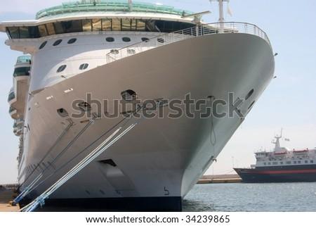 luxury white cruise ship in port - stock photo