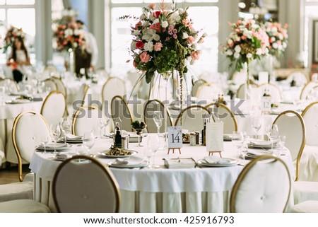 Luxury white restaurant is prepared for the wedding - stock photo