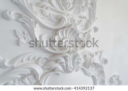 Luxury white wall design bas-relief with stucco mouldings roccoco element. Elements of torsel ornament for use as a texture or background - stock photo