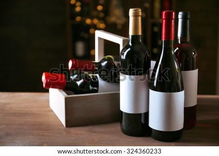Luxury wine bottles on the table - stock photo