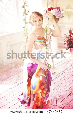 Luxury woman in fashionable dress in rich interior - stock photo