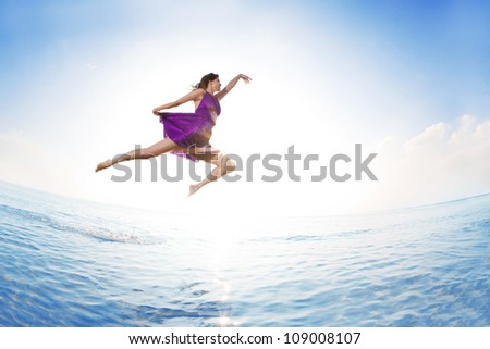 Luxury woman outdoors by the ocean - stock photo
