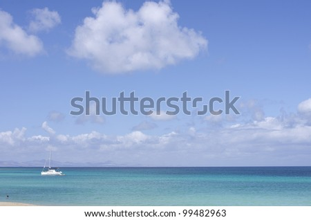 Luxury yacht at the ocean. Nice blue sky with some clouds - stock photo