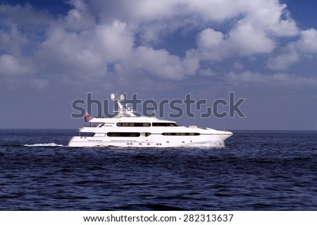 Luxury yacht sailing in open waters - stock photo