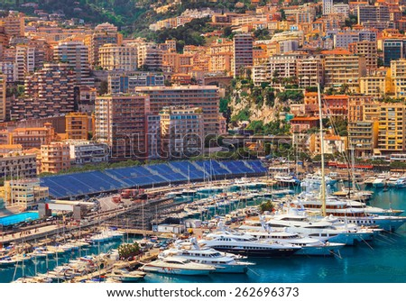 Luxury yachts and formula 1 grandstand in the bay of Monaco, France - stock photo