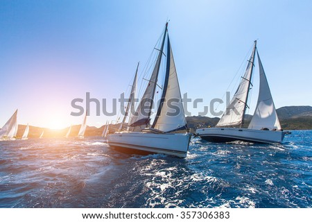 Luxury yachts at Sailing regatta. Sailing in the wind through the waves at the Sea.  - stock photo