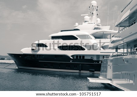 Luxury yachts in port, digitally retouched and toned photo. - stock photo