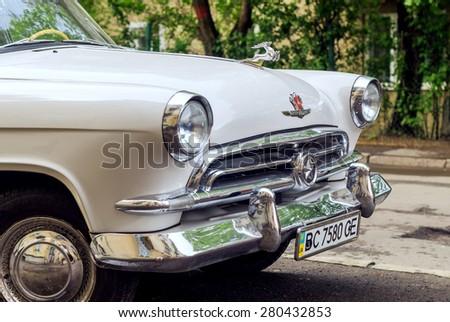 Lviv, Ukraine, April 29, 2015: GAZ 21 Volga 1st Series vintage car (released circa 1957 in USSR) parked on the street. - stock photo