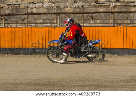 Lviv, Ukraine - 17 April 2016: Unknown rider overcomes the track at the  Flat Track  National Championship series to the Lviv city - stock photo