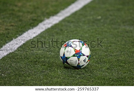 LVIV, UKRAINE - FEBRUARY 17, 2015: Close-up official UEFA Champions League season 2014-2015 ball on the grass during the game between Shakhtar Donetsk and FC Bayern Munich at Arena Lviv stadium - stock photo