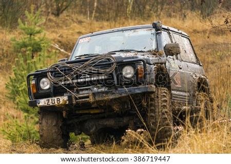 Lviv, Ukraine - February 21, 2016: Off-road vehicle brand Nissan overcomes the track on a polygon near the city Lviv, Ukraine - stock photo