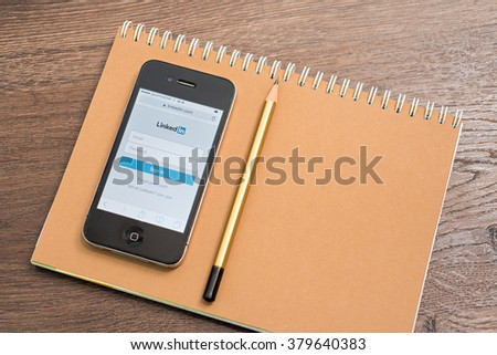 LVIV, UKRAINE - Febt 16, 2016: iphone with Linkedin.com homepage on the screen. LinkedIn is a business-oriented social networking service - stock photo