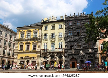 LVIV, UKRAINE - JUNE 13, 2015: Market (Rynok) square of Lviv - the central square and most popular touristic place in historical part of town  - stock photo