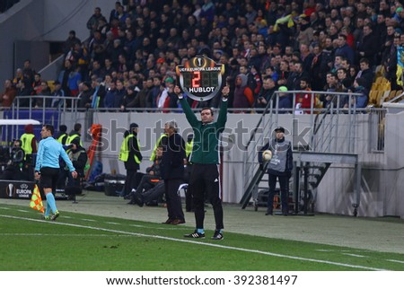 LVIV, UKRAINE - March 10, 2016: Assistant referee show an indicator board with additional time during UEFA Europa League Round of 16 game FC Shakhtar Donetsk vs RSC Anderlecht at Arena Lviv stadium - stock photo