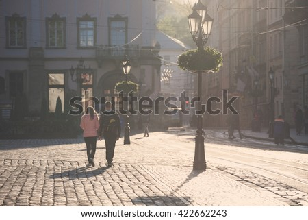 LVIV, UKRAINE - MAY 6, 2016: Morning streets of Lviv city. Old city center square. - stock photo