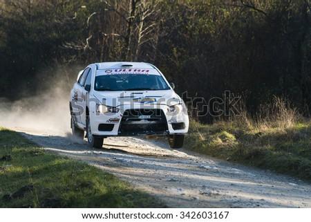 Lviv, Ukraine - November 1, 2015: Racer Alexey Dolot  on the car brand Mitsubishi Lancer Evo X  (No.10) overcome the track at the annual Rally of Galicia, near the city of Lviv, Ukraine - stock photo