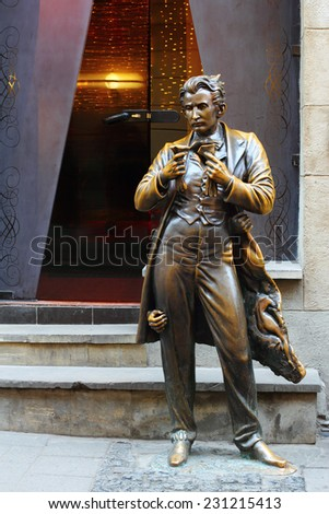 LVIV, UKRAINE - NOVEMBER 15, 2015: Sacher-Masoch statue, located in front of a cafe - one of the most popular places in Lviv. - stock photo
