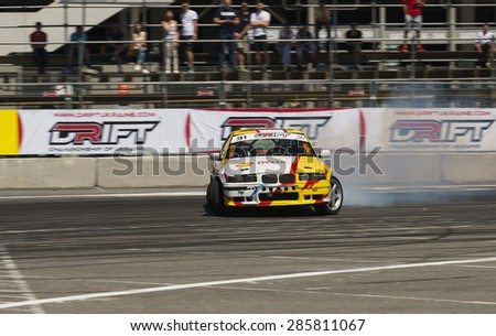 Lvov, Ukraine - June 6, 2015: Unknown rider on the car brand BMW overcomes the track in the championship of Ukraine drifting in Lvov, Ukraine. - stock photo