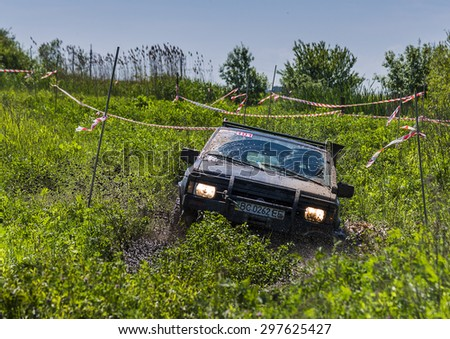 Lvov, Ukraine - May 30, 2015: Off-road vehicle Nissan overcomes the track on of landfill near the city Lvov. - stock photo