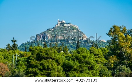 Lycabetus Hill also known as Lykabettos or Lykavittos, is a Cretaceous limestone hill in Athens at 300 meters (908 feet) above sea level. Attica - Greece - stock photo