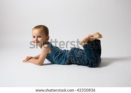 Lying boy - stock photo