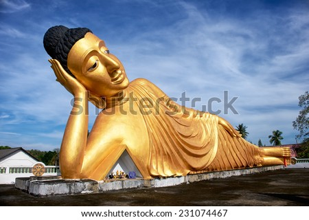 Lying Buddha statue in Wat Sri Sunthon temple on Phuket in Thailand - stock photo