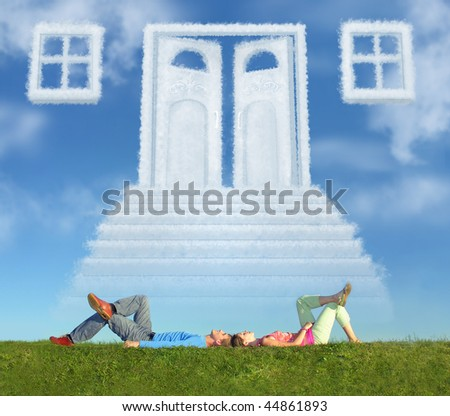 lying couple on grass and dream door way collage - stock photo
