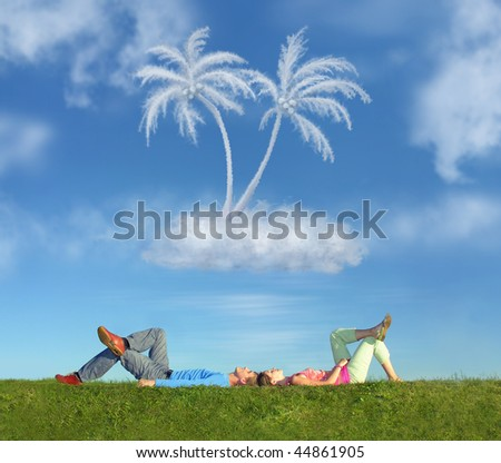 lying couple on grass and dream island collage - stock photo