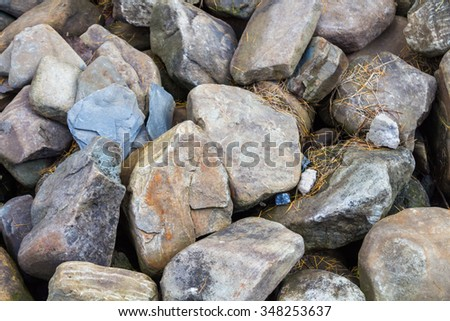 lying large stonesPile of rocks stone in mountains - stock photo