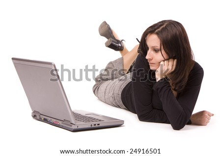lying on floor from crossed legs businesswoman looking on laptop's screen - stock photo