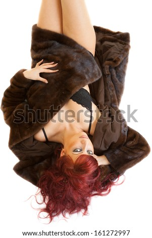 lying sexy young red-haired woman wearing underwear and mink fur coat - stock photo