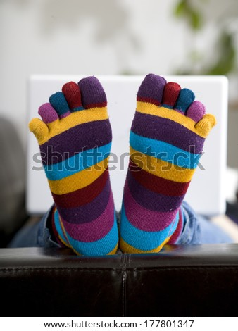 lying woman with white laptop - stock photo