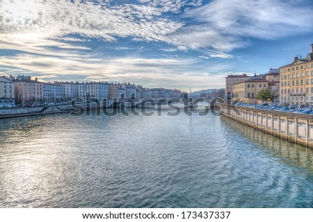 Lyon and the River Saone, France with a view along the riverbanks showing the historical architecture of this French city - stock photo
