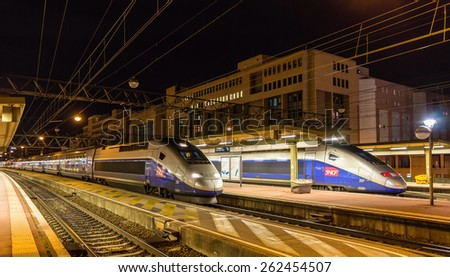 LYON, FRANCE - JANUARY 07: SNCF TGV Duplex trains on January 7, 2014 at Lyon Part-Dieu railway station. TGV trains carried more than 2 billion passengers since startup - stock photo
