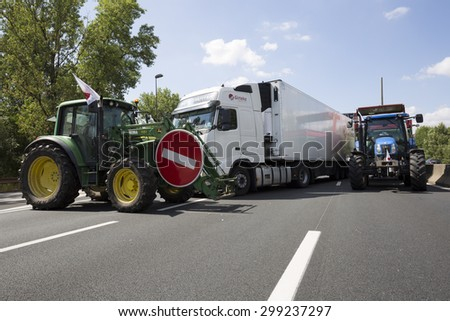 LYON, FRANCE - JULY 23, 2015 : French farmers protest on July 23, 2015 in Lyon. Farmers are demanding better purchase price of their products with great stores. - stock photo