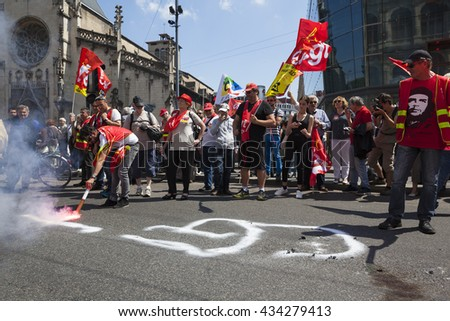 Lyon, France - JUNE 9, 2016 : Thousands of protesters march during a demonstration against the French government and planned labor law reforms - stock photo