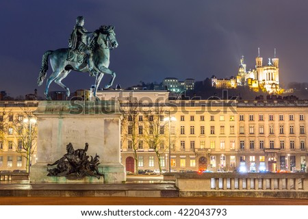 Lyon Place Bellecour statue of King Louis XIV at night France - stock photo