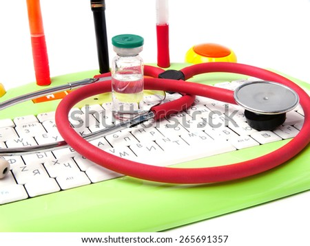 M?edicine, phonendoscope, bottle, the keyboard, ball pens on a white background - stock photo