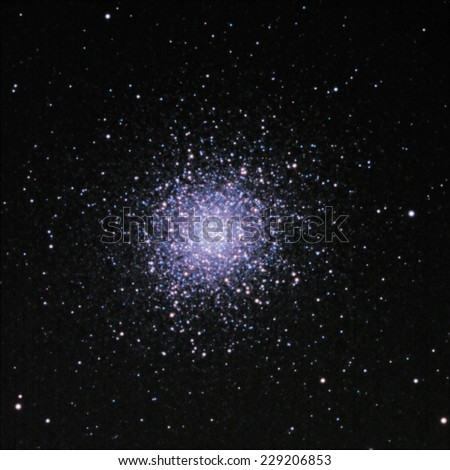 M 13 is an immense globular cluster, located in the constellation Hercules. It is approximately 25,000 light years away, 150 light years in diameter and contains approximately 300,000 stars. - stock photo