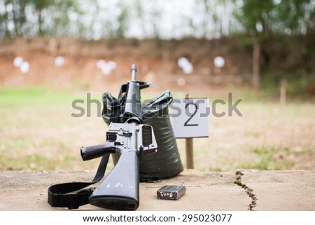 M16 rifle on the shooting field - stock photo