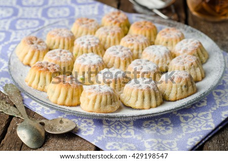 Maamoul or mamoul - arabic cookies stuffed dates with icing cugar on vintage wooden table background. Selective focus - stock photo